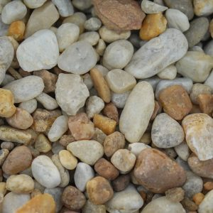 "Gold Pea Gravel Med Over 3/4"" Landscaping Supplies from Field Stone Center Inc. in Covington, GA."